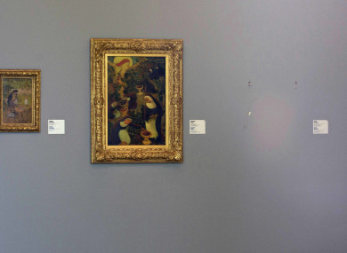 An image from the crime scene showing empty space to the right where paintings hung.