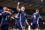 Scotland's James Forrest (centre) celebrates scoring his side's third goal of the game.
