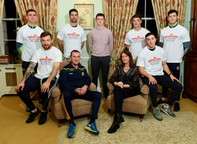 From left: Shane McEntee (Meath), Mickey Burke (Meath), Michael Darragh-Macauley (Dublin), Meath manager Andy McEntee, son of Sean Cox, Jack, wife of Sean Cox, Martina, Eric Lowndes (Dublin), Colm Basquel (Dublin) and Seamus Lavin (Meath).