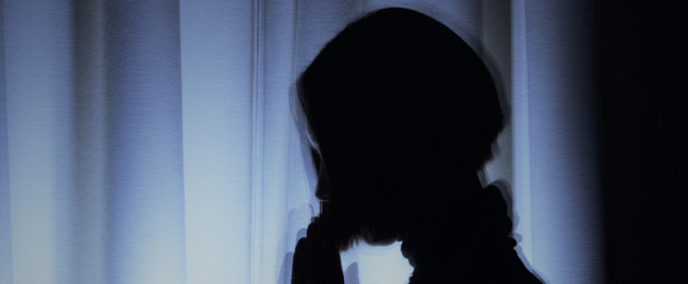 File photo of a young woman's silhouette.