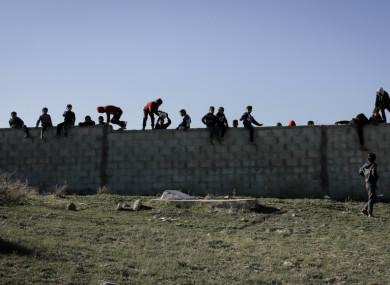 Children on concrete fence in Gaza