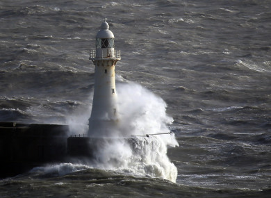 Waves crash against a lightohouse in Dover during Storm Imogen, which caused the MV Epsilon to roll to an angle of 33 degrees.