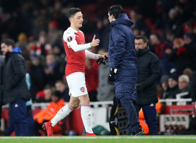Mesut Ozil shakes hands with manager Unai Emery after being substituted during Arsenal's Europa League win over Qarabag.