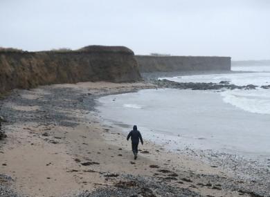 A man walks along a beach in Balbriggan, north of Dublin, near the scene where the body of a newborn baby was found.