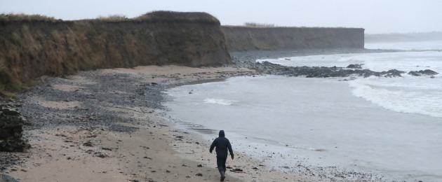 A man walks along a beach in Balbriggan, north of Dublin, near the scene where the body of a newborn baby was found.