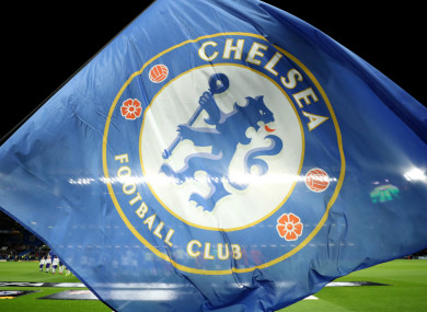 A Chelsea flag is waved at Stamford Bridge