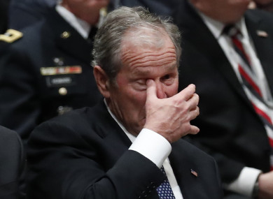 George Bush Jnr wiping a tear during the ceremony