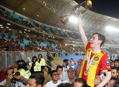 Ben Mohamed holds the African Champions League aloft.