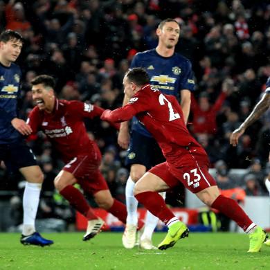 Liverpool's Xherdan Shaqiri celebrates scoring his side's third goal of the game.