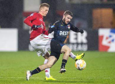 Dan Crowley of Willem II is challenged by AZ Alkmaar's Albert Gudmundsson.