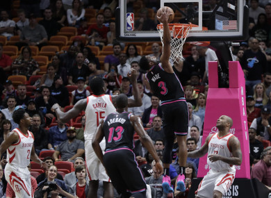 Miami Heat guard Dwyane Wade scores against the Houston Rockets.