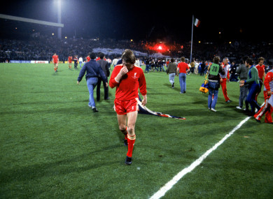 Liverpool's Kenny Dalglish walks off the pitch after his team's 1-0 defeat.
