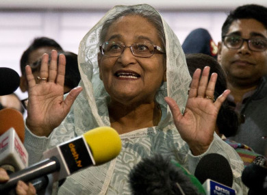 Bangladesh Prime Minister Sheikh Hasina speaks to the media after casting her vote in Dhaka yesterday.