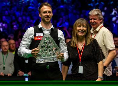 Judd Trump celebrates with the Paul Hunter trophy with his family during day eight of the 2019 Dafabet Masters at Alexandra Palace, London.
