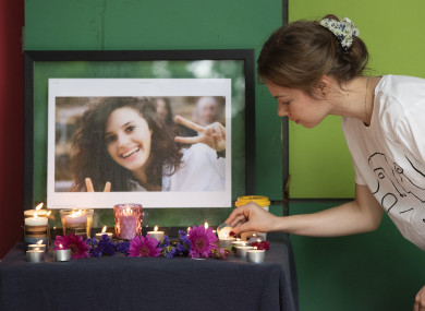 People gather for a vigil in the memory of slain international student Aiia Maasarwe at Latrobe University, Melbourne