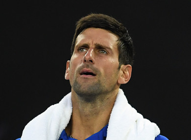 Novak Djokovic of Serbia reacts against Lucas Pouille of France.
