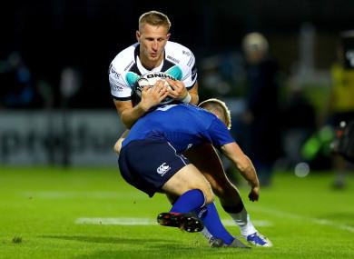Ben John is tackled by Leinster's Garry Ringrose.