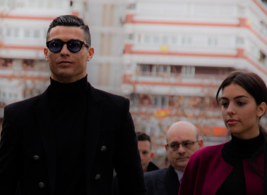Portuguese soccer player Cristiano Ronaldo arrives at the provincial court of Madrid with his girlfriend Georgina Rodriguez for his tax evasion trial.