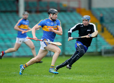 Tipperay's Dan McCormack rounds Clare goalkeeper Donal Tuohy to score their first goal.
