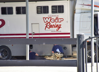 Police are seen at Darren Weir Stables in Miners Rest, Victoria, today.