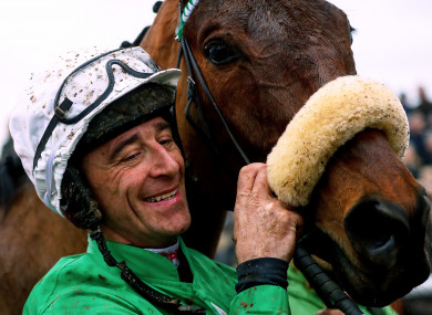 Davy Russell celebrates victory with Presenting Percy.