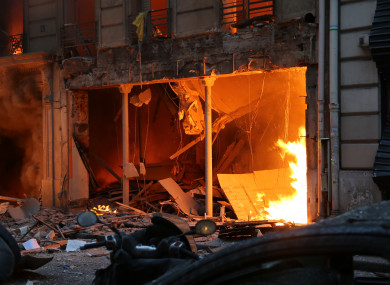 Flames are seen after an explosion at a bakery in central Paris yesterday