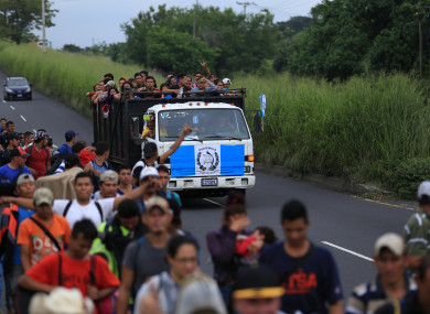 Honduran migrants ride in a truck in a caravan heading to the United States through Guatemala and Mexico