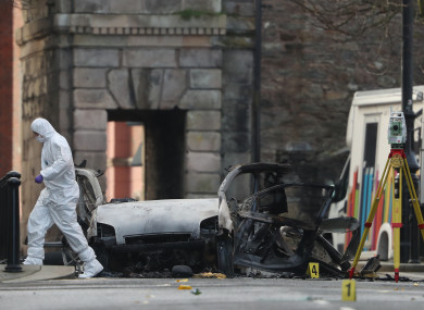 Forensic investigators at the scene of a car bomb blast on Bishop Street in Derry