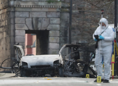 Forensic investigators at the scene of the car bomb in Derry
