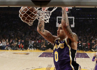 Kyle Kuzma scores for the LA Lakers in their clash with the Detroit Pistons.