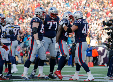 Sony Michel celebrates with James Develin after scoring a touchdown during the second quarter.