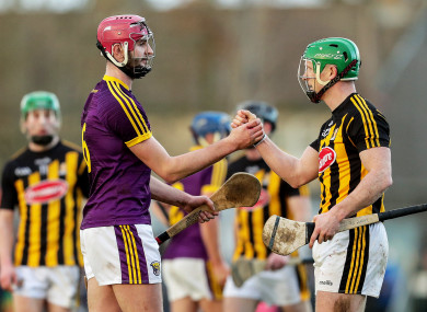 Foley and Paul Murphy shake hands after the game.