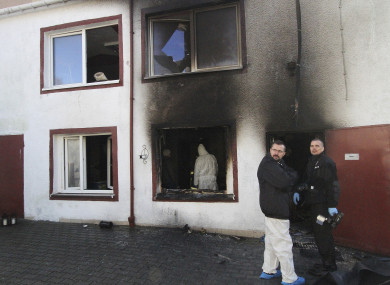 Forensic and other police experts examine the site of a fire in an Escape Room, in Koszalin, northern Poland