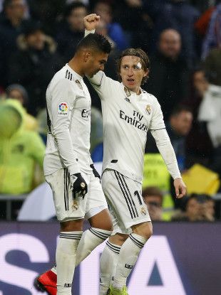 Real Madrid's Luka Modric, right, celebrates his goal with his teammate Casemiro.