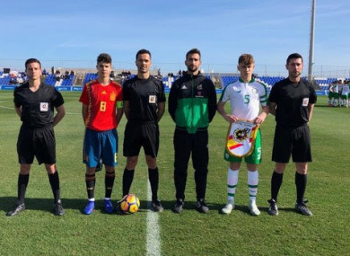Spain captain Aitor Gismera and Ireland skipper Ben Curtis pictured with the officials before today's game.