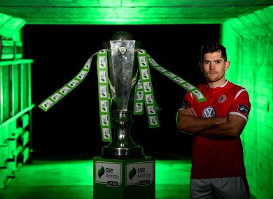 Ronan Murray pictured alongside the Premier Division trophy at the launch of the 2019 SSE Airtricity League season.