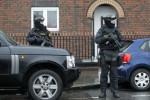 Members of the Garda ERU stand by a Garda Checkpoint in Dublin.