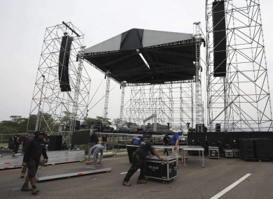 "Workers build the stage for the upcoming ""Venezuela Aid Live"" concert at the Tienditas International Bridge"