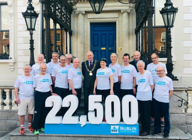 Dublin Lord Mayor Nial Ring at the Mansion House with the runners who have completed all 39 Dublin Marathons.