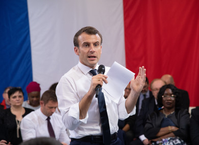 French President Emmanuel Macron attends a meeting with elected officials and local association members as part of the
