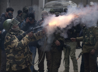 n Indian paramilitary solider fires tear gas shell towards Kashmiri protesters in Srinagar, Indian controlled Kashmir, on Tuesday.