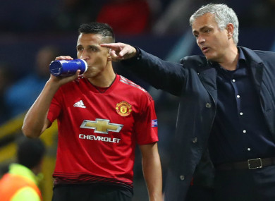 Jose Mourinho alongside Alexis Sanchez