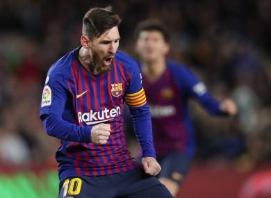Lionel Messi celebrates scoring his second goal against Valencia.