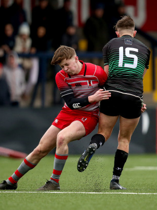 Bandon's Soren Minihane is tackled by William Twomey of Glenstal Abbey at Musgrave Park.