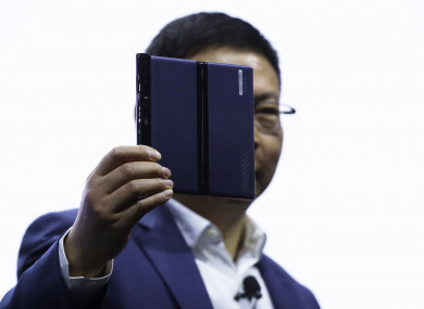 Huawei CEO Richard Yu displays the new Huawei Mate X foldable 5G smartphone at the Mobile World Congress, in Barcelona, Spain,