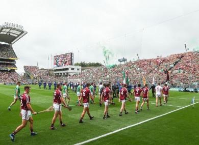 Galway and Limerick players line up before last year's All-Ireland final.