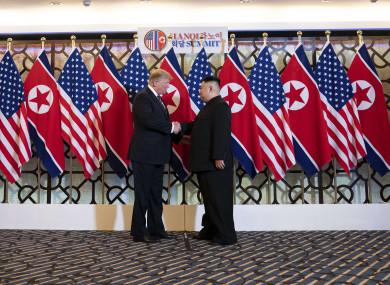 US President Donald Trump and North Korean leader Kim Jong Un greet prior to a bilateral meeting in Hanoi, Vietnam