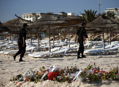 Police officers patrol the beach in Sousse, Tunisia, where 38 people lost their lives after a gunman stormed the beach.