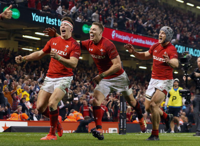 Wales' Josh Adams celebrates scoring his side's winning try against England.