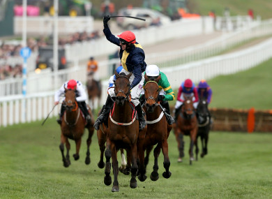 City Island ridden by jockey Mark Walsh wins the Ballymore Novices' Hurdle during Ladies Day.